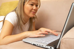 Happy with the laptop Stock Image