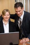 Happy laptop news stock photo