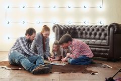 Happy large family playing Board game. Happy large family playing Board game stock images