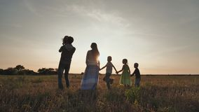 Happy large family of six at sunset. Father throws up his daughter stock video footage