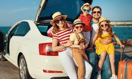 Happy large family  in summer auto journey travel by car on beach royalty free stock images