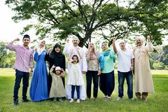 A happy large Muslim family stock images