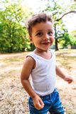 Happy latin-american or afro boy smiling at camera outdoor stock photo