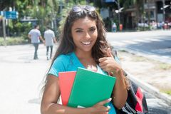 Happy latin american female student. Outdoor in the city royalty free stock image