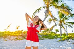 Happy latin beautiful girl in caribbean beach Stock Photography