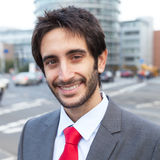 Happy latin businessman with beard in the city Royalty Free Stock Photo