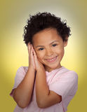 Happy latin child making the gesture of sleep. With a yellow background Stock Photography