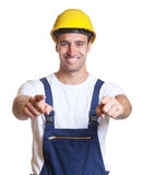 Happy latin construction worker showing both thumbs Stock Images