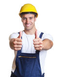 Happy latin construction worker showing both thumbs Stock Photography
