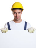 Happy latin construction worker with whiteboard Royalty Free Stock Images