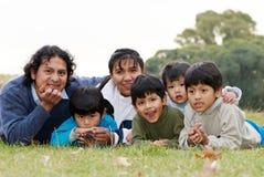 Happy Latin family. In the park Royalty Free Stock Photos