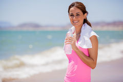 Happy Latin girl drinking water Royalty Free Stock Photography