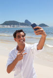 Happy latin guy making selfie at Copacabana beach Stock Image