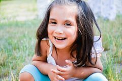 Latin kid laughing in the summer park. stock photo