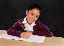 Happy Latin little girl with notepad smiling in back to school concept Royalty Free Stock Photography