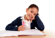 Happy latin little girl with notepad smiling in back to school and education concept Stock Photo