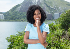 Happy latin woman with curly black hair outdoor on a sea. In the summer Royalty Free Stock Photography