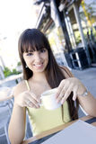 Happy latin woman drinking coffee Stock Photography