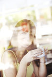 Happy latin woman drinking coffee Royalty Free Stock Image