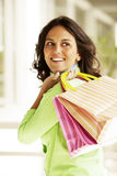 Happy latin woman with shopping bags Royalty Free Stock Photo