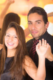 Happy latin young couple dancing in a nightclub Stock Image