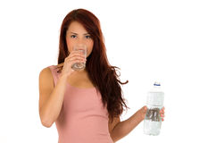 Happy latin young girl drinking water side view Stock Photos