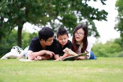 Happy latino family reading book Royalty Free Stock Image