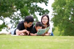 Happy latino family reading book Stock Images