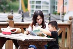 Happy latino family reading book royalty free stock photography