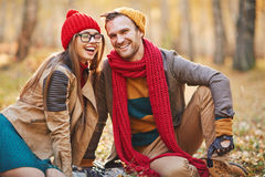 Happy laugh. Affectionate young dates laughing during rest in park Royalty Free Stock Photo