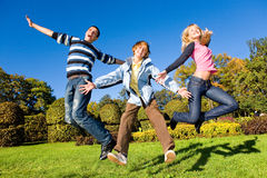 Happy laugh young team. Blue sky Royalty Free Stock Photo