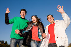 Happy laugh young team. Blue sky Stock Photography