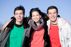 Happy laugh young team. Smiling under blue sky Stock Image