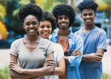 Happy laughing african american young adults in line stock photo