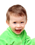 Happy laughing baby. In green isolated on white Royalty Free Stock Photography