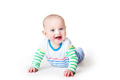 Happy laughing baby boy playing on his tummy Royalty Free Stock Photos