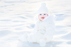 Happy laughing baby girl playing in snow Stock Photography