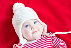 Happy laughing baby girl wearing a white hat Stock Images