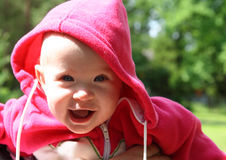 Happy laughing baby outdoors Stock Photography