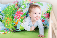 Happy laughing baby playing peek-a-boo Royalty Free Stock Images
