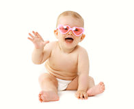 Happy laughing baby sitting in sunglasses playing Stock Photos