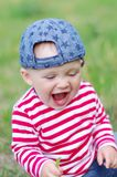Happy laughing baby in summer. Happy laughing baby age of 10 months in summer Royalty Free Stock Photography