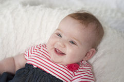 Happy laughing beautiful infant baby Royalty Free Stock Image