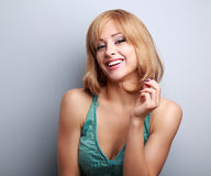 Happy laughing blond yound woman with short hairstyle. Closeup p Royalty Free Stock Photography
