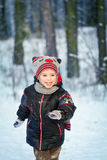 Happy laughing boy in a beautiful snowy winter forest Royalty Free Stock Photography