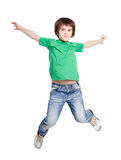 Happy laughing boy jumping on white isolated background Royalty Free Stock Photography