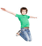 Happy laughing boy jumping on white isolated background Royalty Free Stock Photos