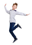 Happy laughing boy jumping on white isolated background Stock Image