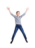 Happy laughing boy jumping on white isolated background Stock Images