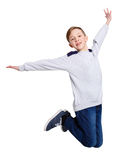 Happy laughing boy jumping on white isolated background Stock Photos
